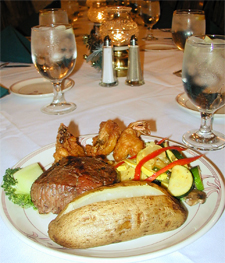 Curtis Michigan Fine Dining - Offering a variety of tasty fare, classic cuisine, cocktails and specialty drinks. Come and enjoy dinner by the fireside in our Lakeview Dining Room; our Forest Room is the perfect place for groups to gather whether for a private dinner party or quiet meeting area. The Pub's libations, sports and tales are tops, and warm weather can best be enjoyed on the Veranda with quaint outdoor seating and breathtaking views.