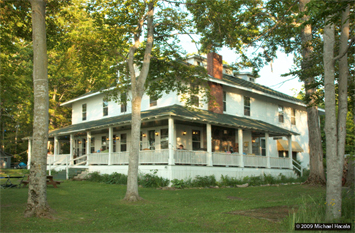 Curtis Michiga Lodging, Curtis Michigan Accommodations:  Welcome to Chamberlin's Ole Forest Inn, nestled high on a bluff overlooking Big Manistique Lake in Michigan's Upper Peninsula.  This incredible lakeside country inn offers charming Curtis Accommodations, Casual Fine Dining, Pub, Events and Entertainment, and great area Things to do.  We invite you to browse our website and relax with us at the inn.